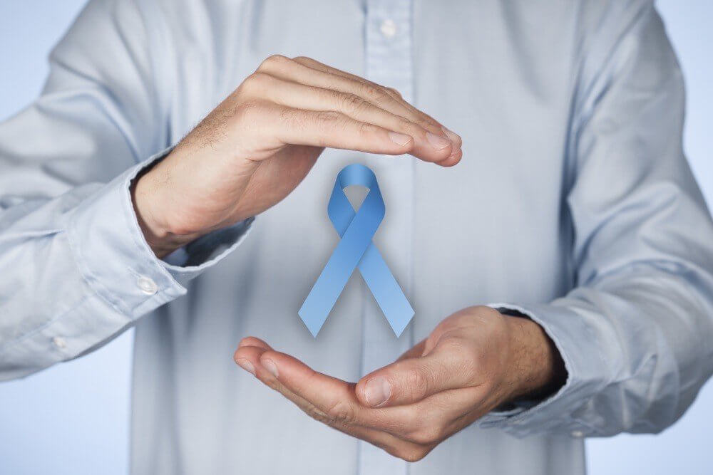 A color blue ribbon with a hand of a man above and below of it